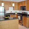 Kitchen with stainless appliances and custom bamboo cabinets